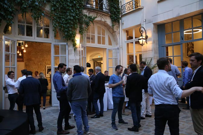 Courtyard of Sociabble leader of employee advocacy solutions filled with people mingling in the evening